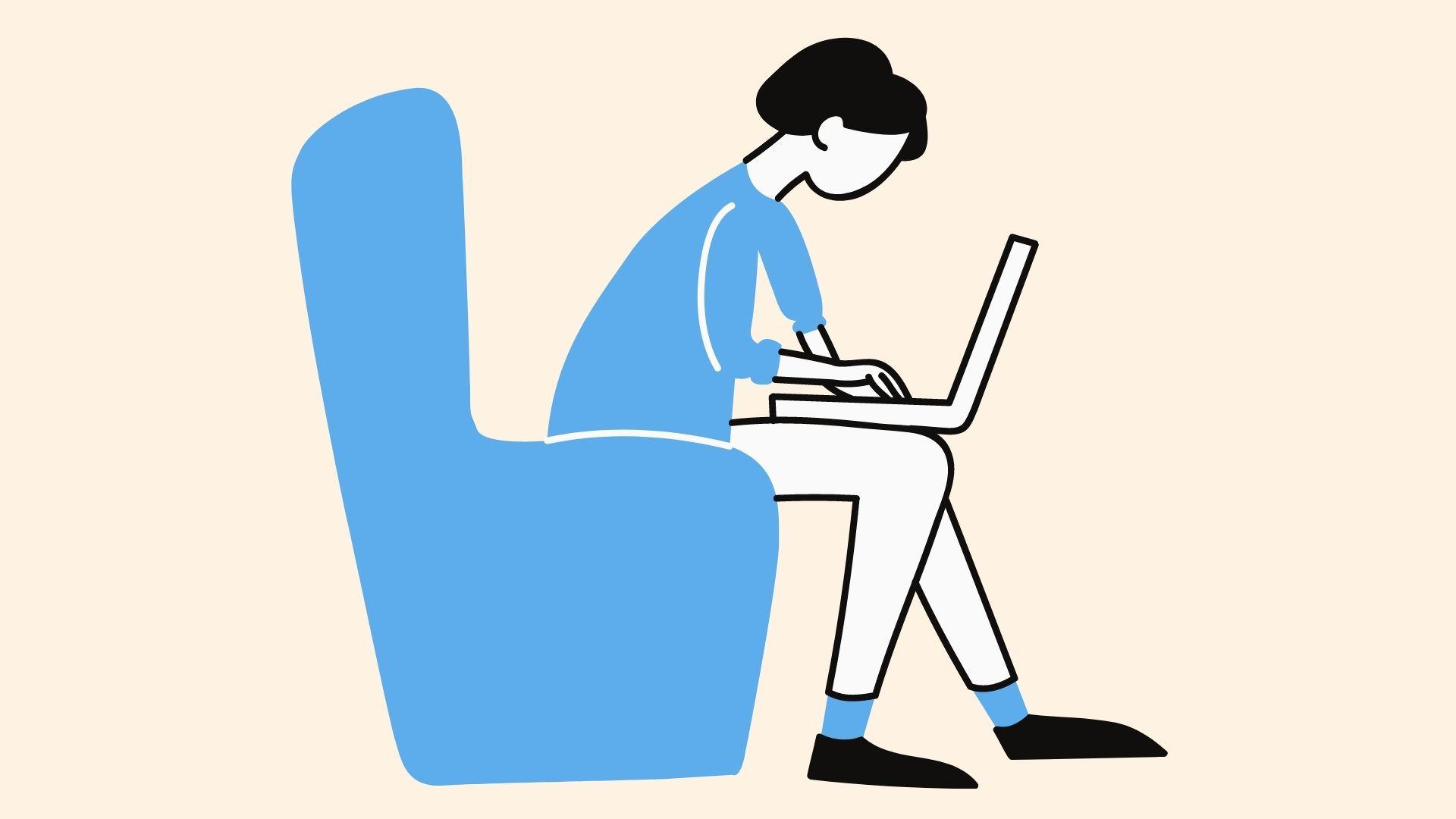 イスに座って作業する女性